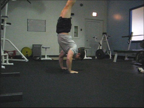 clapping handstand pushup 12